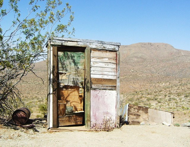 Mojave desert outhouse dilapidated.