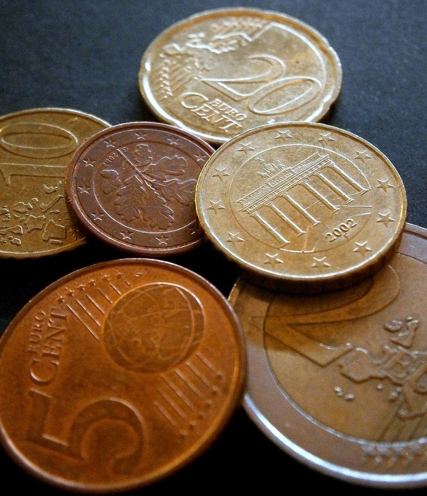 Money cash and cash equivalents loose change, business finance.