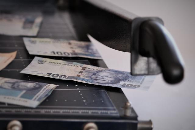 Money cutting machine decline in value, business finance.