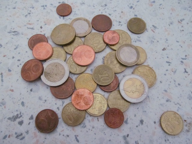 Money loose change coins, business finance.