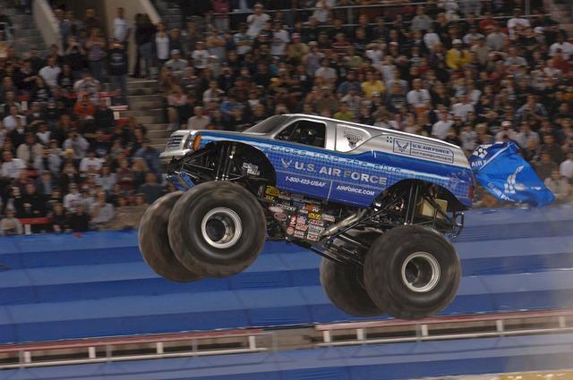 Monster truck jam rally, transportation traffic.