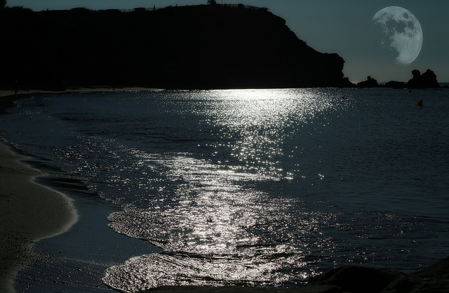 Moon sea light reflections, travel vacation.
