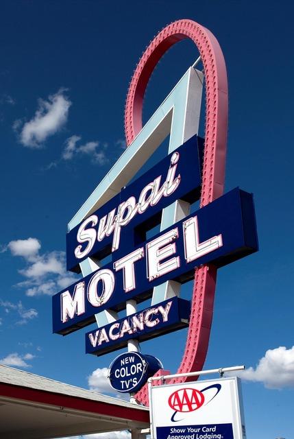 Motel shield advertising sign.
