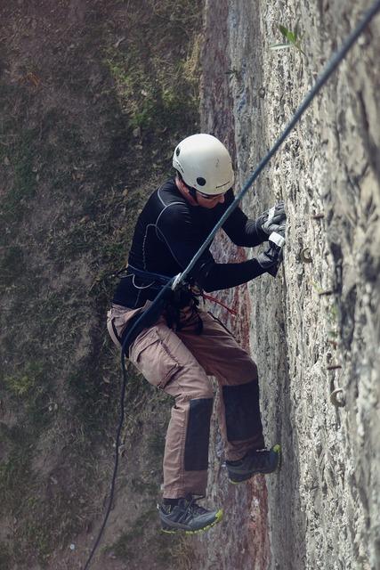 Mountain climber mountain climbing rappelling, sports.