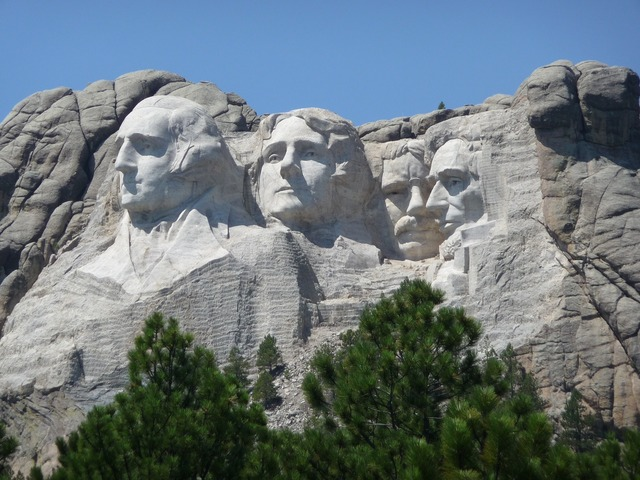 Mountain rushmore stone carving, nature landscapes.