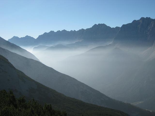 Mountains fog back light.