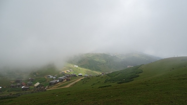 Mountains fog cottage.