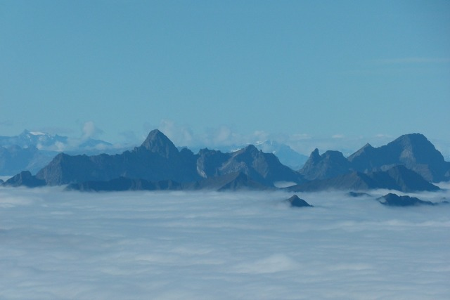 Mountains summit sea of fog.