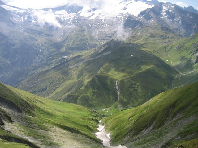 Mountains valleys snow summit.