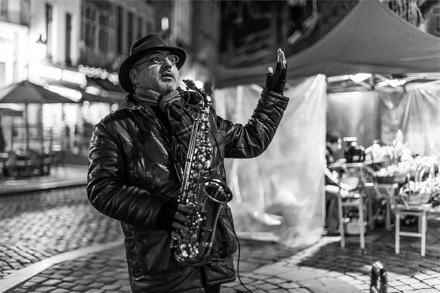Musician street performer saxophone, music.