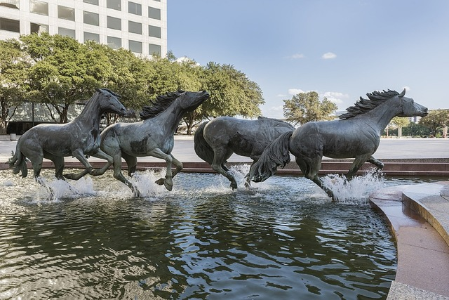 Mustangs sculpture fountain, architecture buildings.