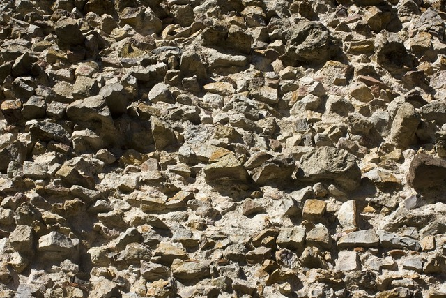 Natural stone wall sand stone wall, backgrounds textures.