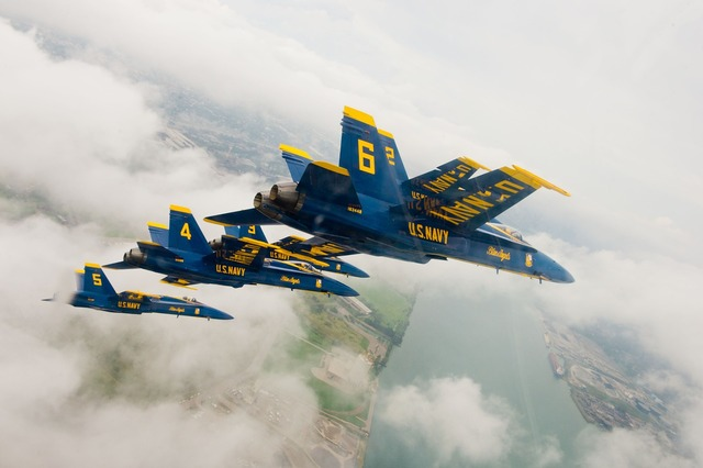 Navy blue angels flying aircraft.