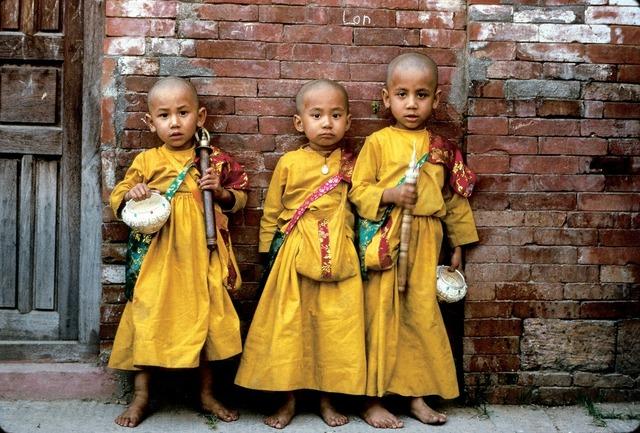 Nepal children native dress, architecture buildings.