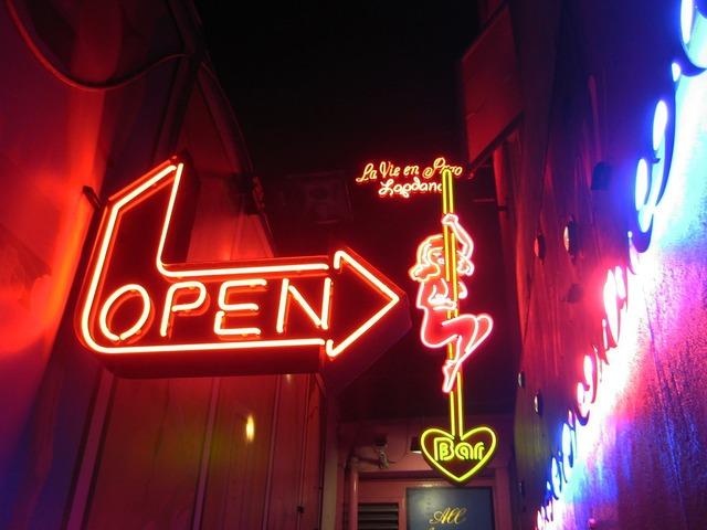 Night club neon lights advertisement.
