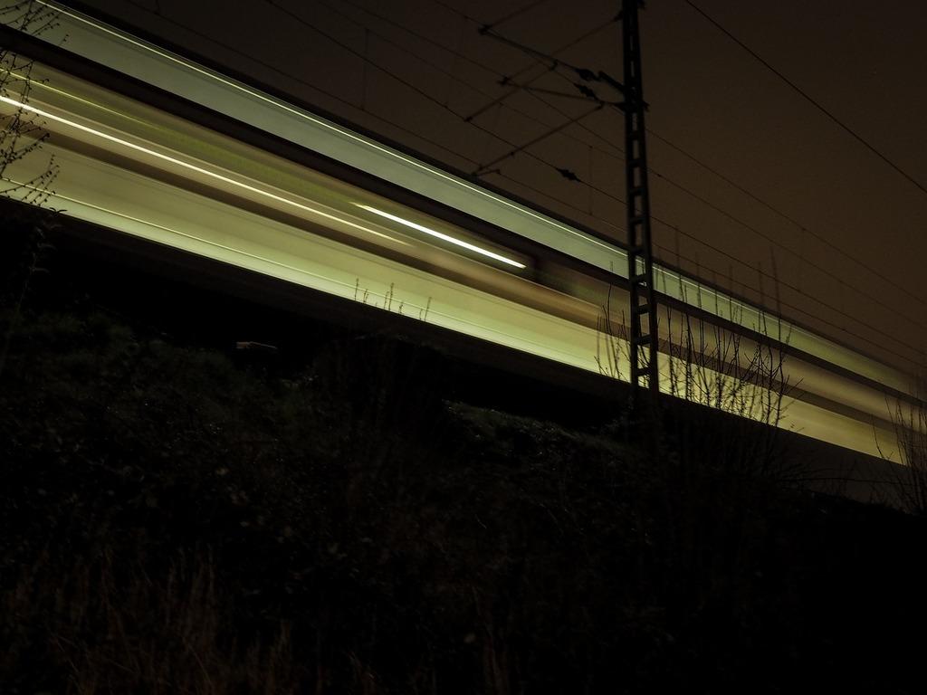 Night train train level crossing, transportation traffic.
