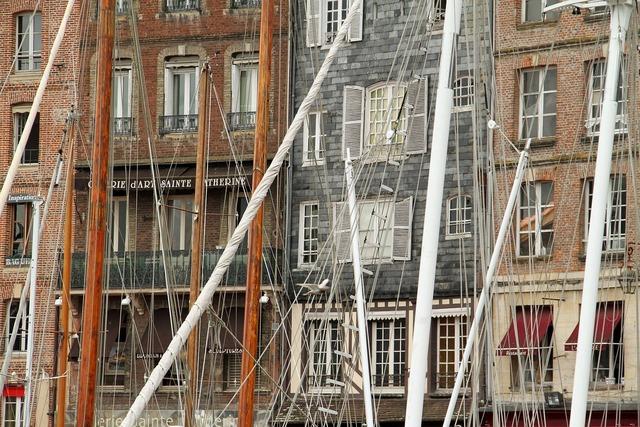 Normandy port ship masts.