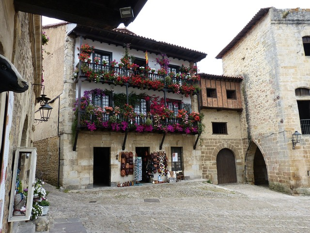 Old town balcony flowers, architecture buildings.