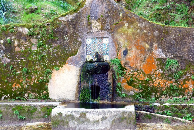 Old well weathering fountain.