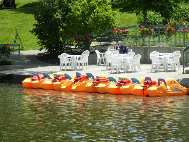 Paddle boats coffee house river.