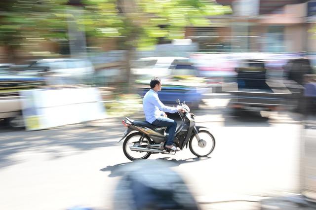 Panning motorcycle motor, people.