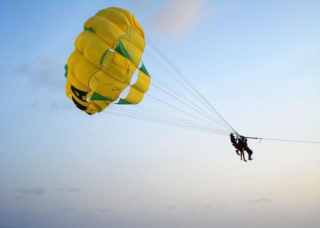 Parachute jumping man, people.