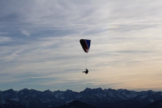 Parachutist mountains parachute.