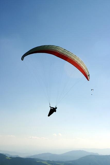 Paragliding a parachute the sky.