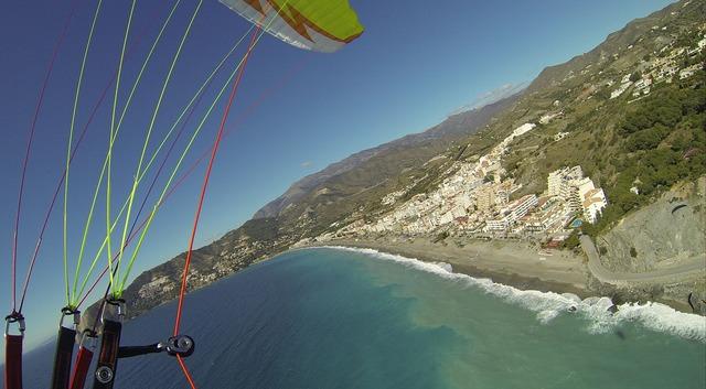 Paragliding sea beach, travel vacation.