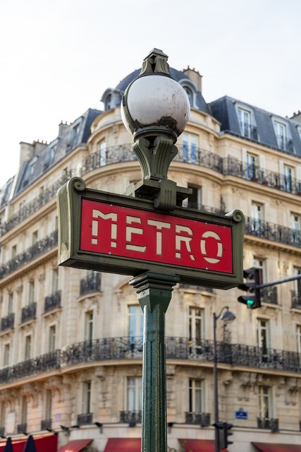 Paris metro entrance, transportation traffic.
