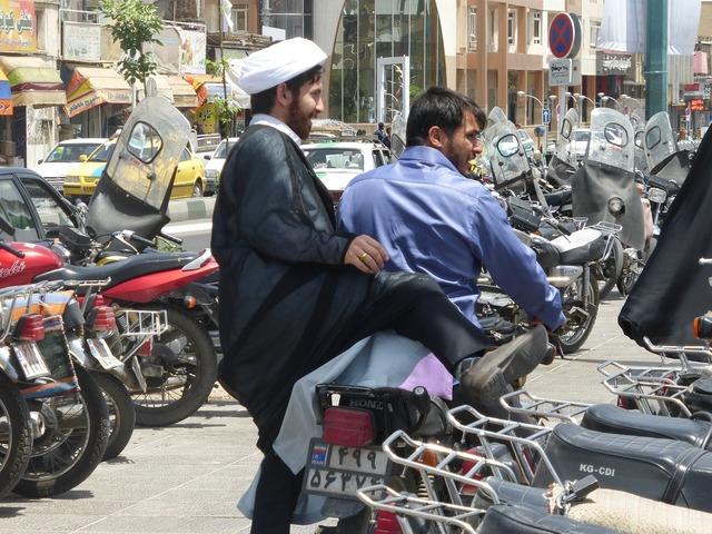 Passengers moped qom, transportation traffic.