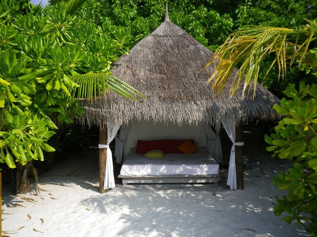 Pavilion thatched roof bed.