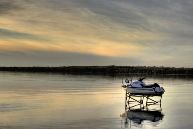 Personal watercraft lake sunset, travel vacation.