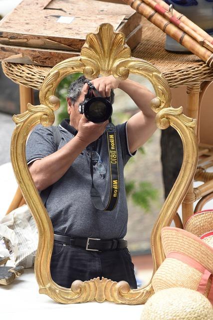 Photographer mirror flea market.