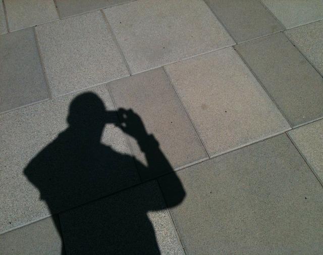 Photographer shadow light and shadow.