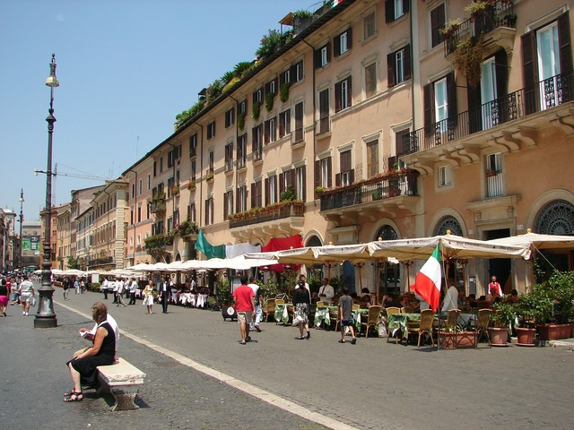 Piazza navona city square buildings, transportation traffic.