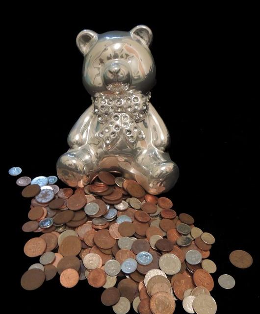 Piggy bank teddybear coins, business finance.