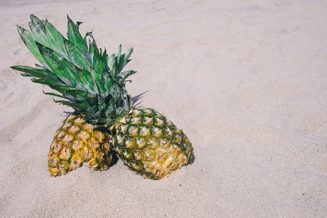 Pineapples sand beach, travel vacation.