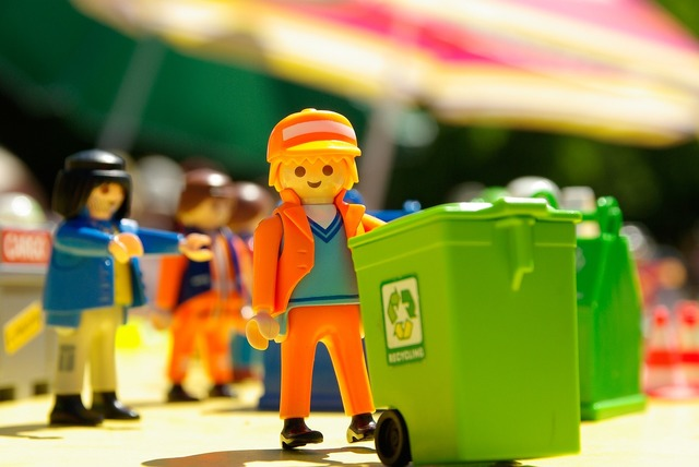 Playmobil toy garbage collector.