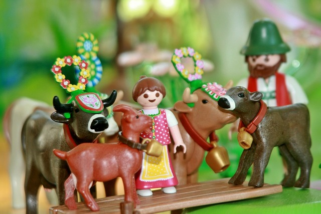 Playmobil toys cows, people.