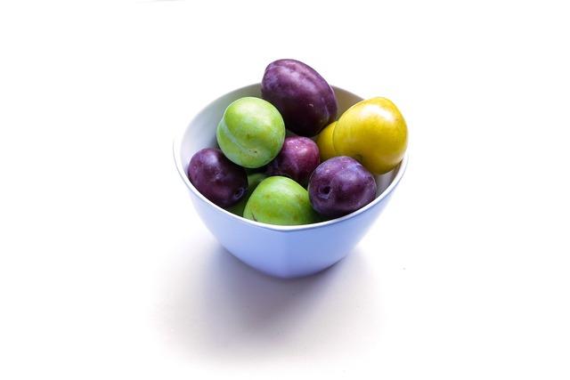Plum eating healthy food, food drink.