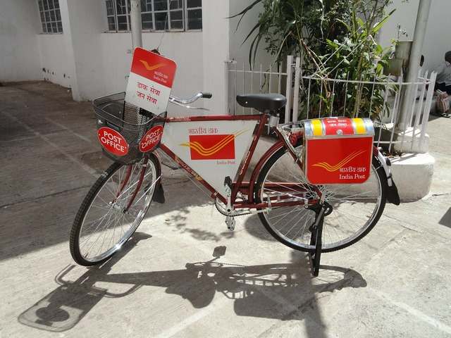 Postman bike post office india, transportation traffic.