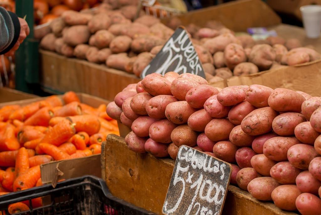 Potatos carrots vegetables, food drink.