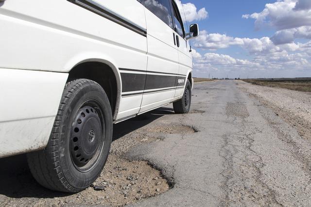 Pothole road kazakhstan, transportation traffic.