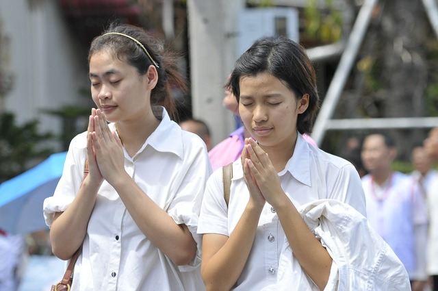 Praying buddhists thai, religion.