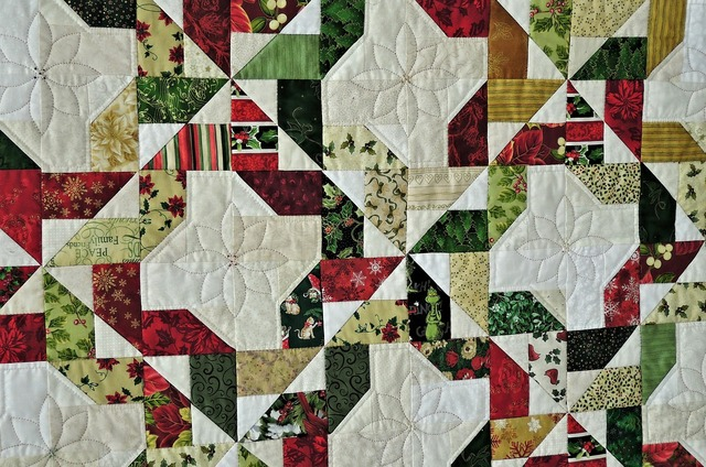 Prize winning quilt hand made fabrics, backgrounds textures.