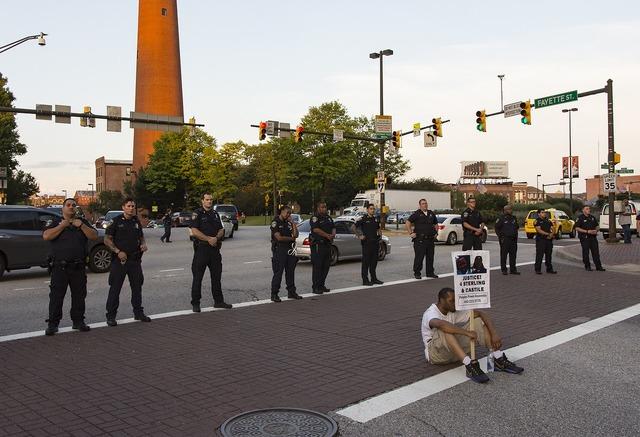 Protest black lives matter sign, architecture buildings.