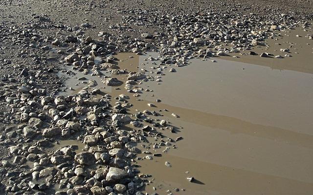 Puddle crushed stone dirt, transportation traffic.