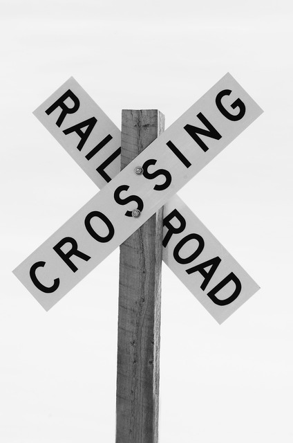 Railroad crossing sign black and white, transportation traffic.