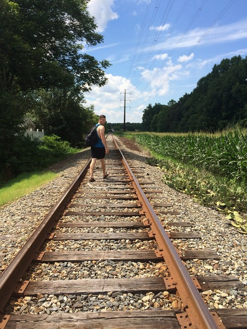 Rails railroad tracks, people.